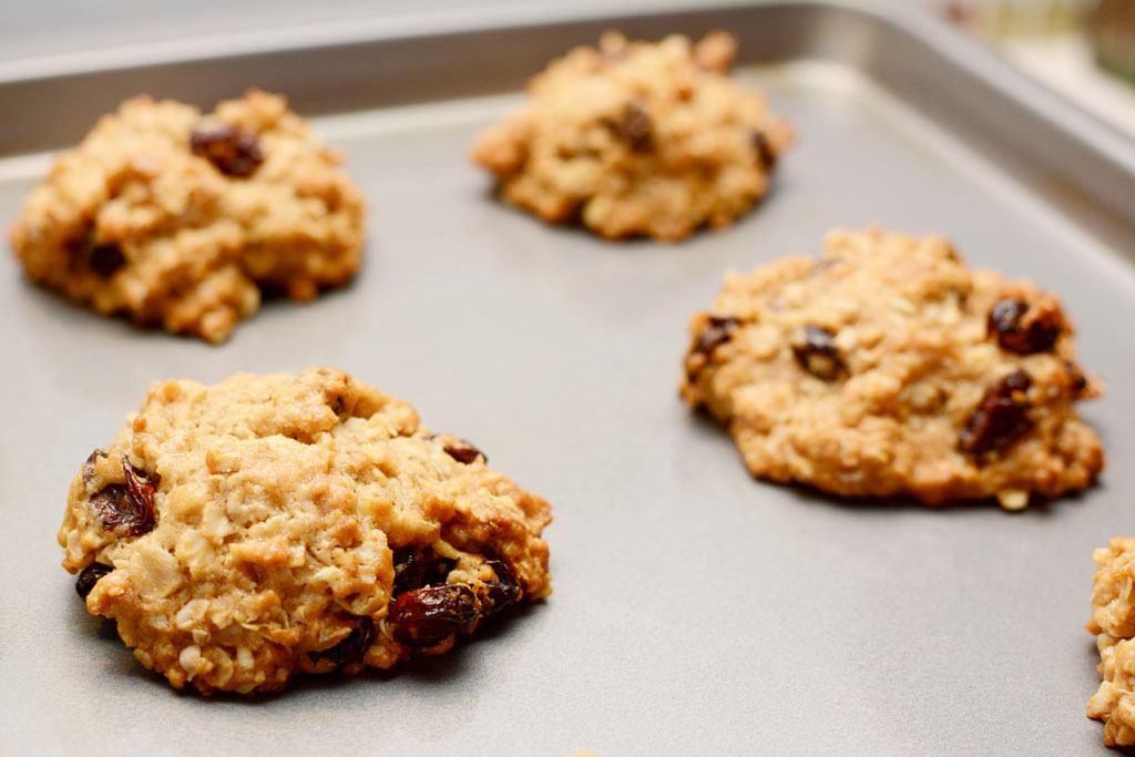 Oatmeal raisin cookies on a baking sheet.