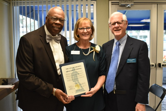 Commissioner Willie Charles Shaw shares the City of Srsota's proclamation with Jefferson Center Administrator Dawn Lucido and Jefferson Center Foundation President James Keeney.