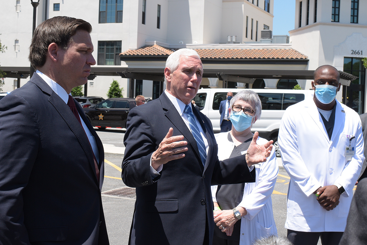 From left, DeSantis and Pence speak with Schultz and Romelus about the challenges of providing a safe environment for residents and team members.