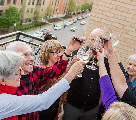 Residents enjoying a glass of wine at Abiitan Mill City in Minneapolis MN